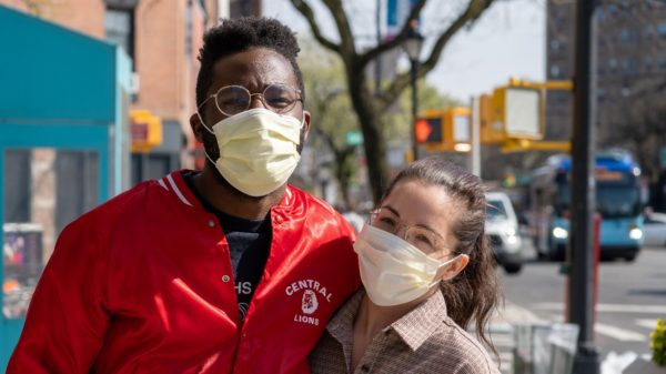A couple on the sidewalk during the pandemic